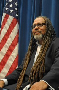 Hari Jones seated with an American flag